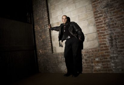 Eddie Star leaning against a wall in a freight elevator.